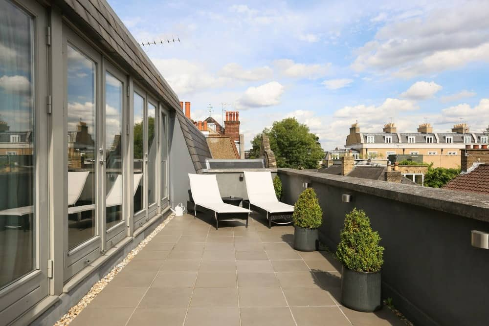 Here's a look at the home's roof terrace featuring a couple of sitting lounges. Images courtesy of Toptenrealestatedeals.com.