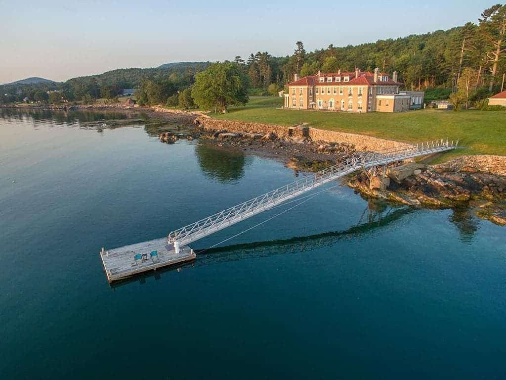This aerial view of the house showcases its close proximity to the water's edge along with a private dock that cab anchor a large yacht. Images courtesy of Toptenrealestatedeals.com.