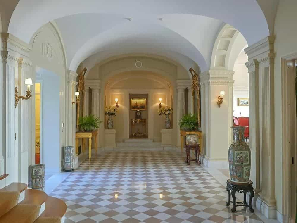 The wide space of the marble foyer is maximized with small yet elegant decors placed on the sides with console tables, jars and potted plants. Images courtesy of Toptenrealestatedeals.com.