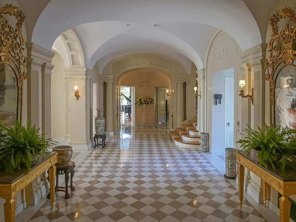 The marble floor of the foyer has a beige and white checkered design that fits quite well with the groin-arched ceiling and arched entryways lining the sides. Images courtesy of Toptenrealestatedeals.com.