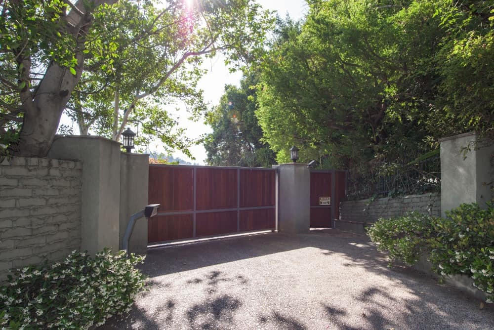A look at the gated entry of the house surrounded by the home's greenery. Images courtesy of Toptenrealestatedeals.com.