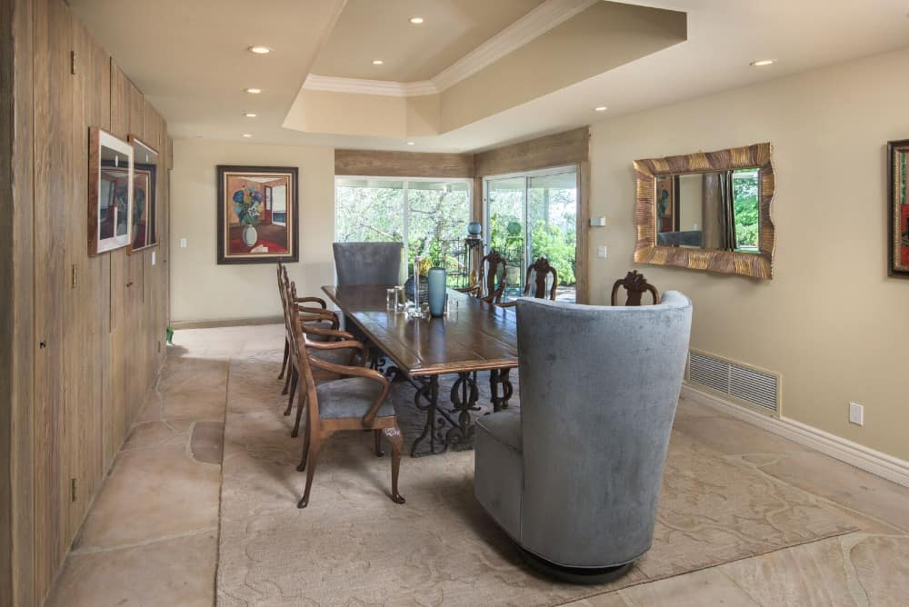 Formal dining room with an elegant dining table and chairs set, situated just under the area's tray ceiling. Images courtesy of Toptenrealestatedeals.com.