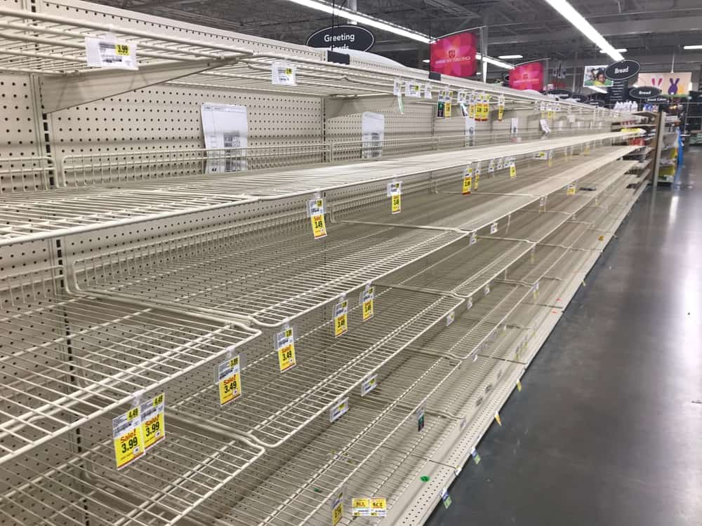 Empty bread shelves at a grocery store.