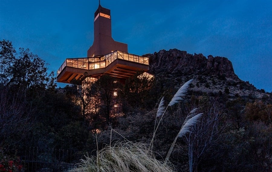 This is a night time view of the Falcon Crest from the bottom of the mountain slope. The house lights up with a warm and welcoming glow like a beacon against the dark mountainside. Images courtesy of Toptenrealestatedeals.com.