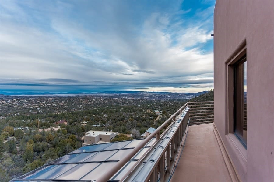 This is the gorgeous sweeping view from the vantage point of the balcony. This is just above the glass ceiling of the great room below with metal railings for safety. Images courtesy of Toptenrealestatedeals.com.