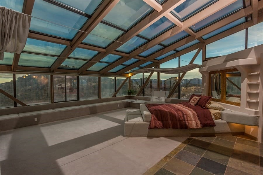 This angle shows more of the bedroom and the structure that the bed is attached to. it has built in shleves and cabinetry that saves space leaving most of the floor free. Images courtesy of Toptenrealestatedeals.com.