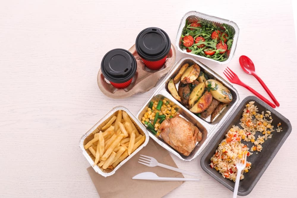 Top view of takeout meals.