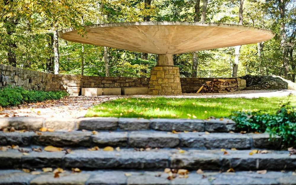 This is the gorgeous and eclectic carport that has a large mushroom-like structure to serve as a roof for the parked cars. Images courtesy of Toptenrealestatedeals.com.