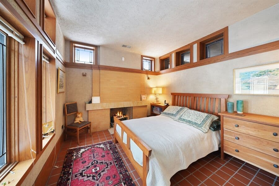 This bedroom offers a comfy bed set with a fireplace on the side. Images courtesy of Toptenrealestatedeals.com.