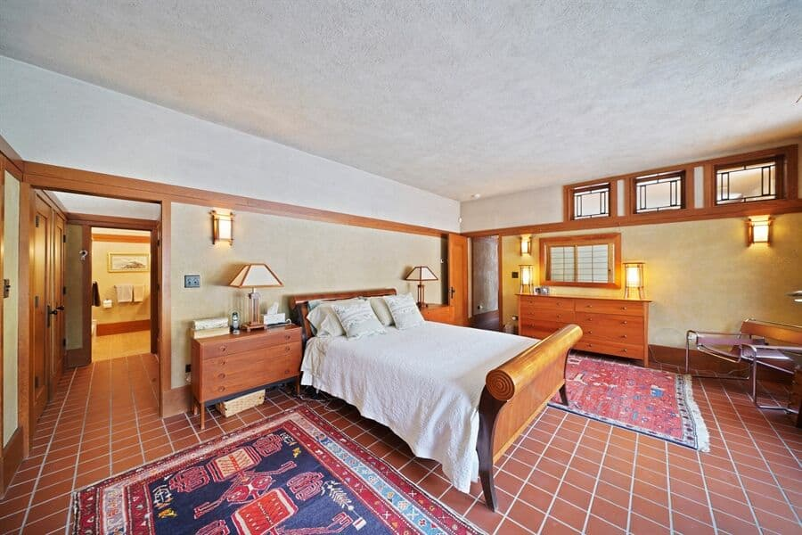 This bedroom suite features its own personal bathroom. The classy bed is also has two bedside tables topped by table lamps. Images courtesy of Toptenrealestatedeals.com.