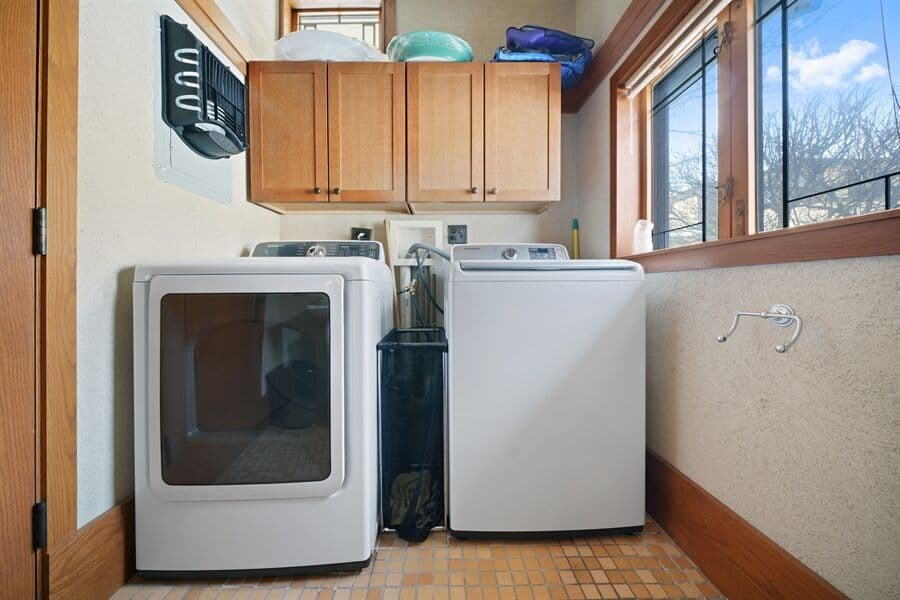 There's a laundry room as well, featuring a washer and a dryer. Images courtesy of Toptenrealestatedeals.com.