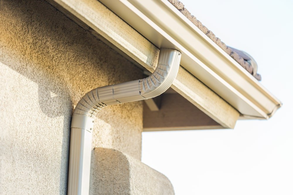 This is a close look at the seamless aluminum rain gutter of the house.