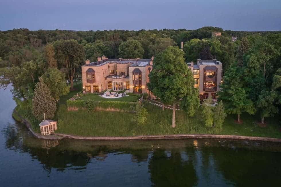 This is the aerial view of the mansion from the vantage of the lake. Here you can see the proximity and elevation of the mansion in relation to the lake giving it a sweeping overlooking view of the lake and the surrounding tall trees. Images courtesy of Toptenrealestatedeals.com.