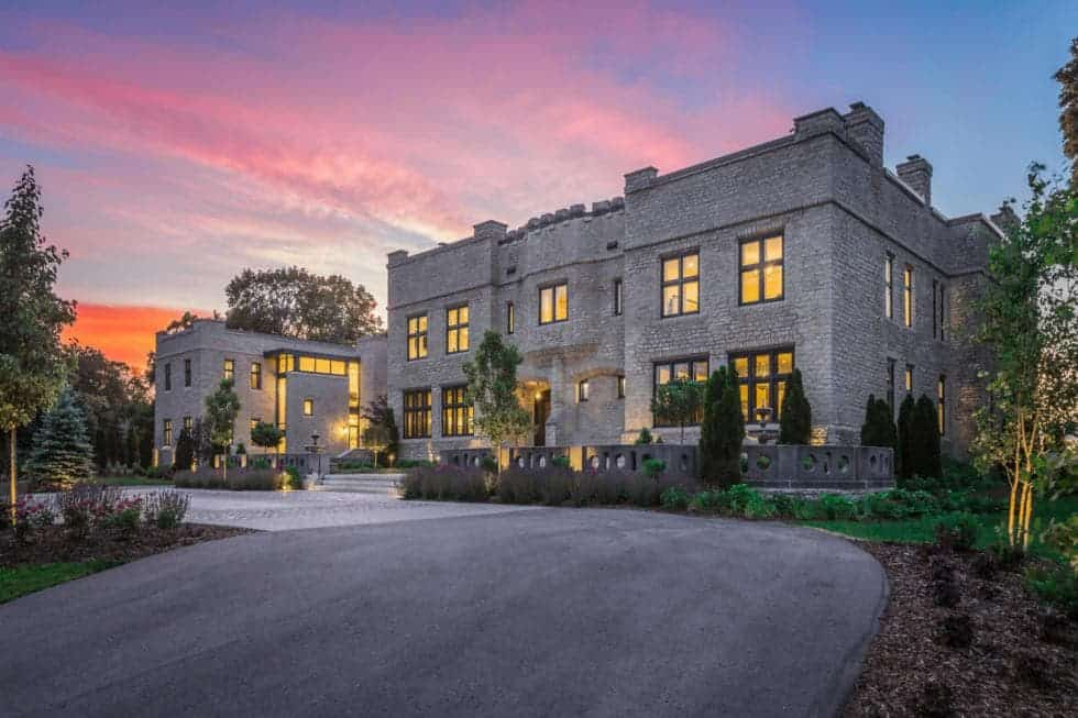 This is the beautiful front view of the castle replica mansion showing its gray brick exterior walls complemented by warm square windows and wonderfully foregrounded by a wide driveway and front lawn with lovely landscaping. Images courtesy of Toptenrealestatedeals.com.