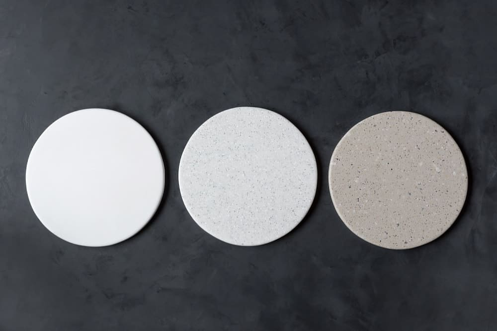 A set of round coasters made of artificial stone.