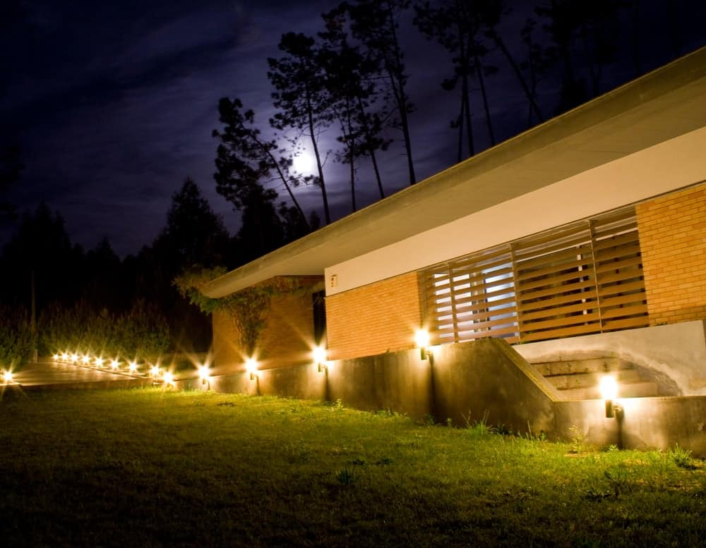 A house illuminated by its outdoor lighting.