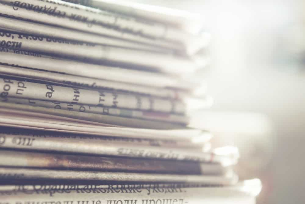 A close-up of a stack of newspapers.