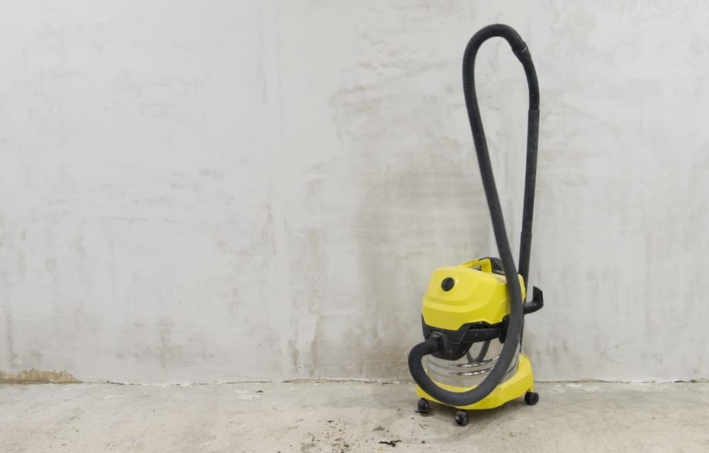 A vacuum cleaner on a concrete background.