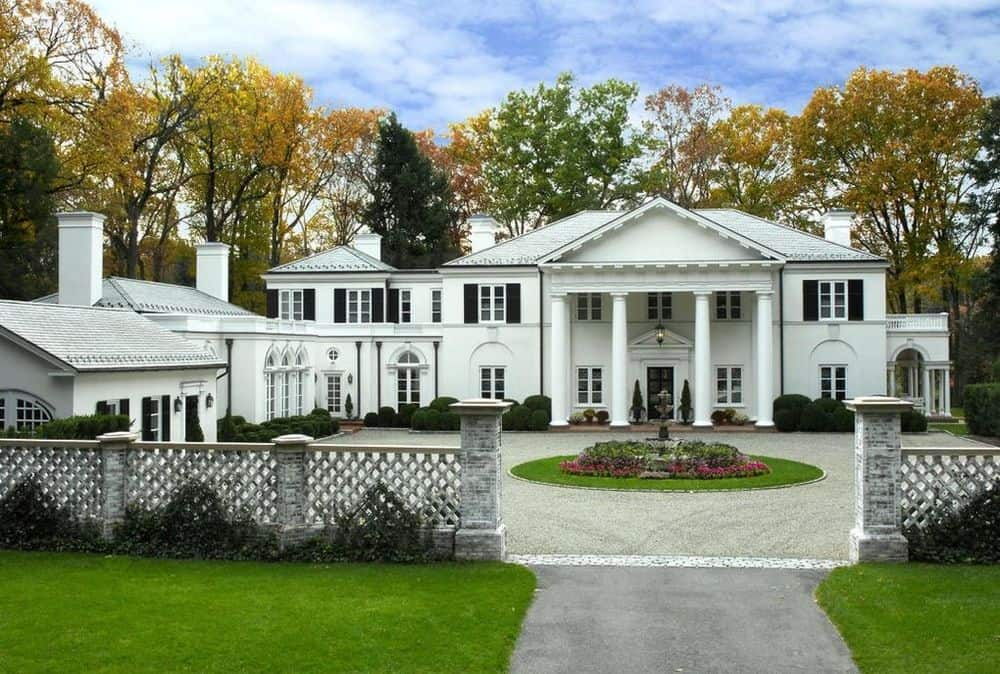 This is a classic Palladian-style home with tall classic pillars supporting the large ceiling of the main entry across from the fountain of the driveway and courtyard. Images courtesy of Toptenrealestatedeals.com.