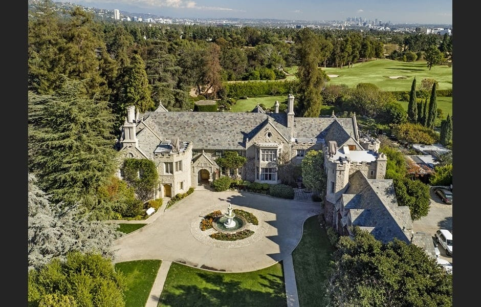 This aerial view of the mansion shows just how massive the house is. This also shows the isolation and privacy afforded by the large piece of land that is field with tall trees. Images courtesy of Toptenrealestatedeals.com.