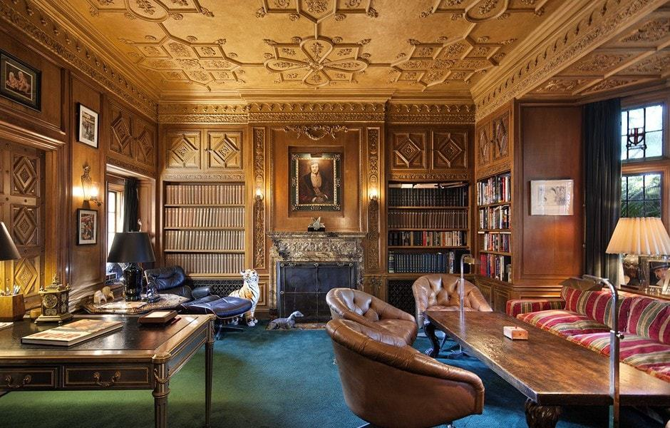 This is the elegant and luxurious home office with a tall intricate amber ceiling, large fireplace and a couple of desks on a charming carpeted floor. Images courtesy of Toptenrealestatedeals.com.