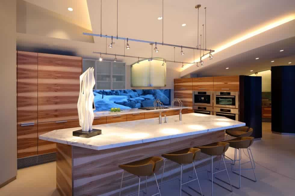 The large kitchen island is paired with modern stools for the breakfast bar across from the faucet area. Images courtesy of Toptenrealestatedeals.com.