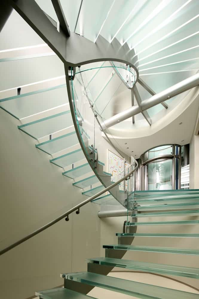 This is the gorgeous staircase that is made of glass and steel as an alternative to using the glass elevator. This has a beautiful aesthetic that evokes a sense of wonderment. Images courtesy of Toptenrealestatedeals.com.