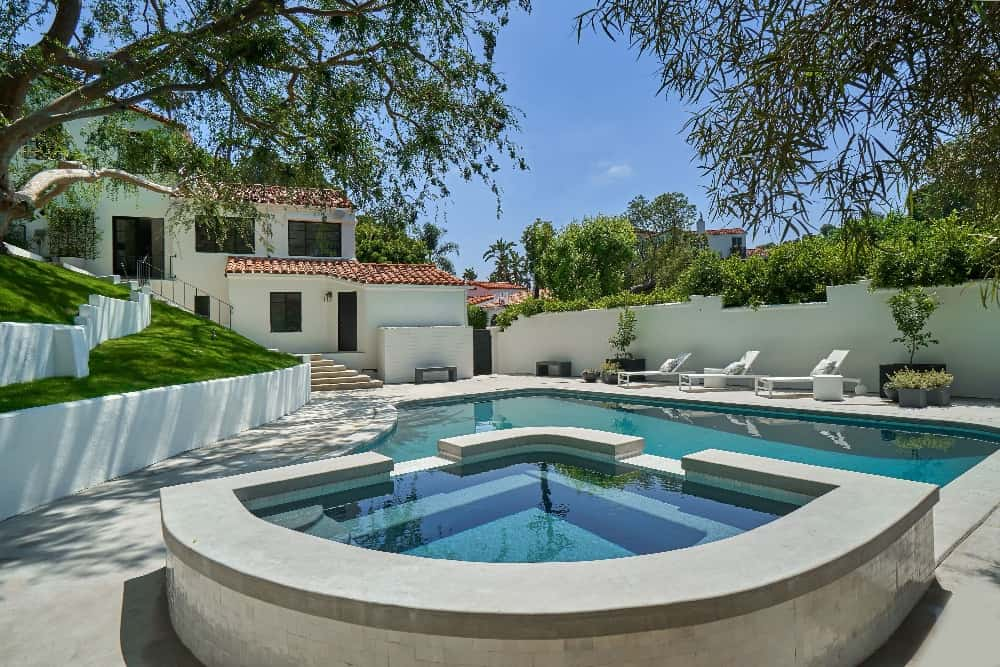 There's a custom swimming pool outside, featuring sitting lounges on the side. Images courtesy of Toptenrealestatedeals.com.