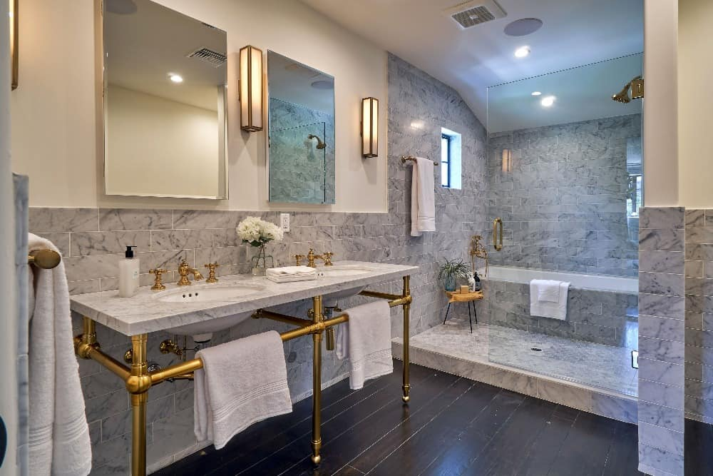 This bathroom features hardwood flooring and a classy double sink. There's a walk-in shower as well as a drop-in soaking tub. Images courtesy of Toptenrealestatedeals.com.