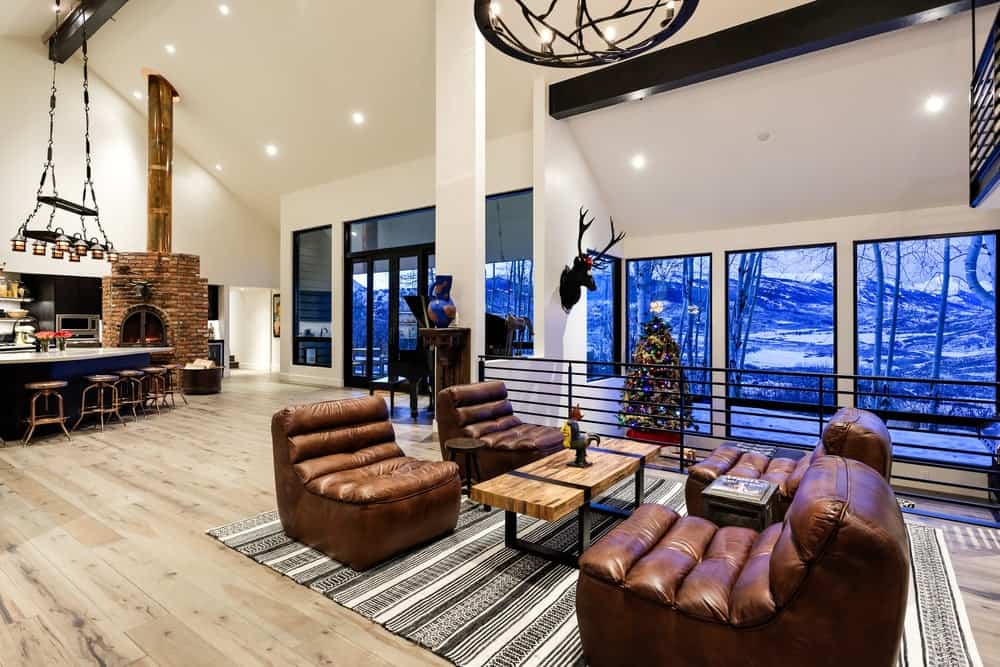 There is another living room just a few steps away from the fireplace. This area works great as a reception area with its proximity from the foyer. Images courtesy of Toptenrealestatedeals.com.