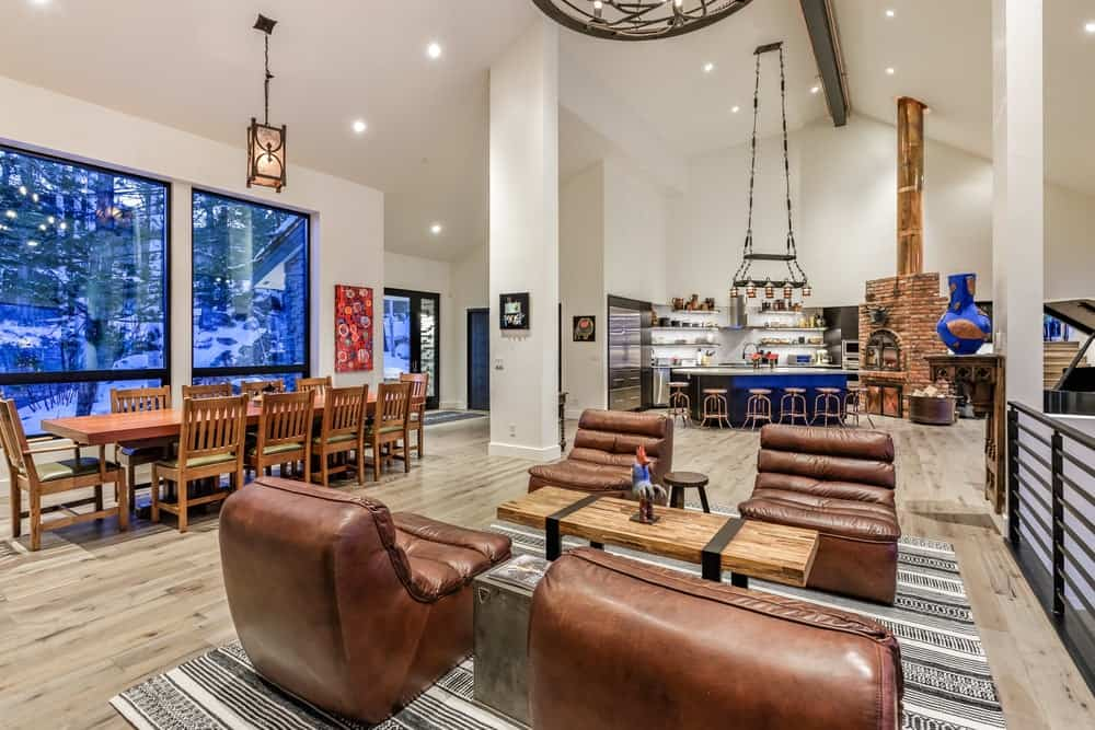 This view shows more of the great room that houses the living room, dining area and kitchen all under the same tall arched ceiling and on the same hardwood flooring. Images courtesy of Toptenrealestatedeals.com.