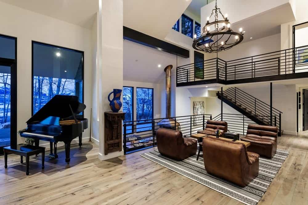 This view shows the proximity of the foyer to the reception area that is topped with an impressive large two-tiered chandelier. You can also see here that the pillar by the piano is adorned with a floating wooden shelf bearing a decorative jar. Images courtesy of Toptenrealestatedeals.com.