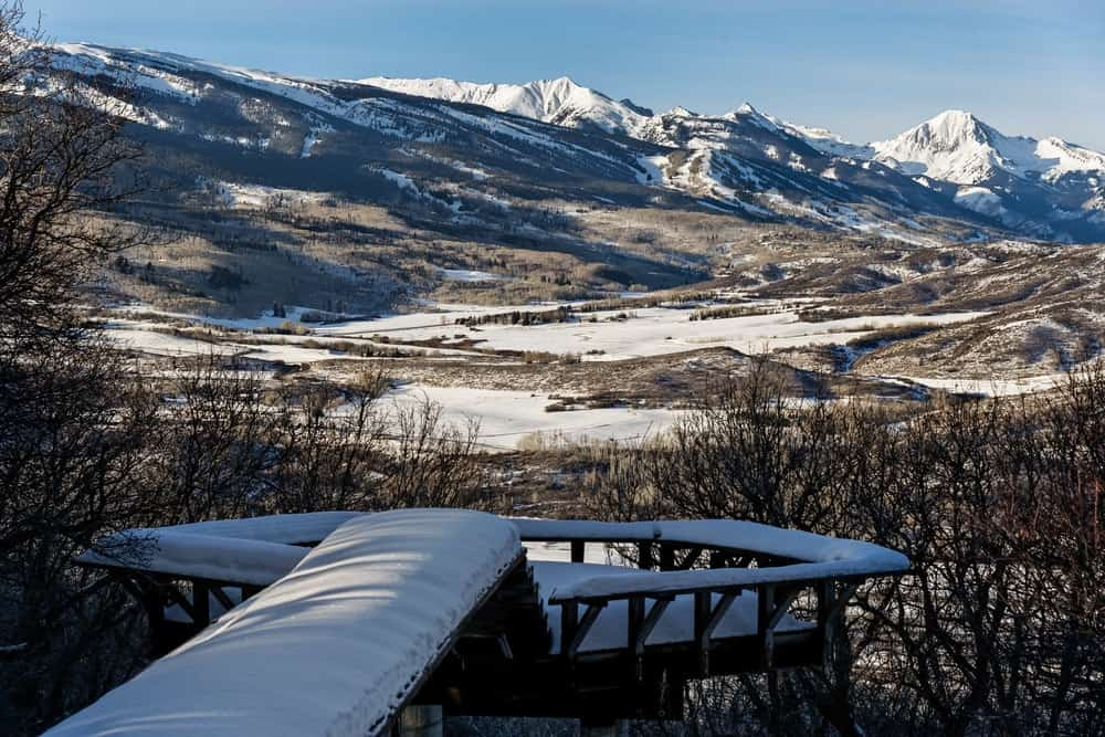This is a closer view of the gorgeous rocky mountain scenery that the house offers. This scenery can inspire and relax at the same time and it gives you more reason to curl up close by the fireplace. Images courtesy of Toptenrealestatedeals.com.