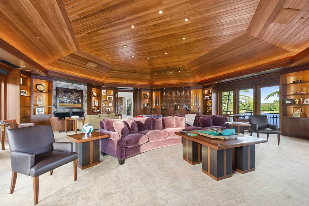 Aside from the bar and foosball table, the club room also has comfortable sofas and chairs for relaxation paired with matching wooden coffee tables and side tables. Images courtesy of Toptenrealestatedeals.com.