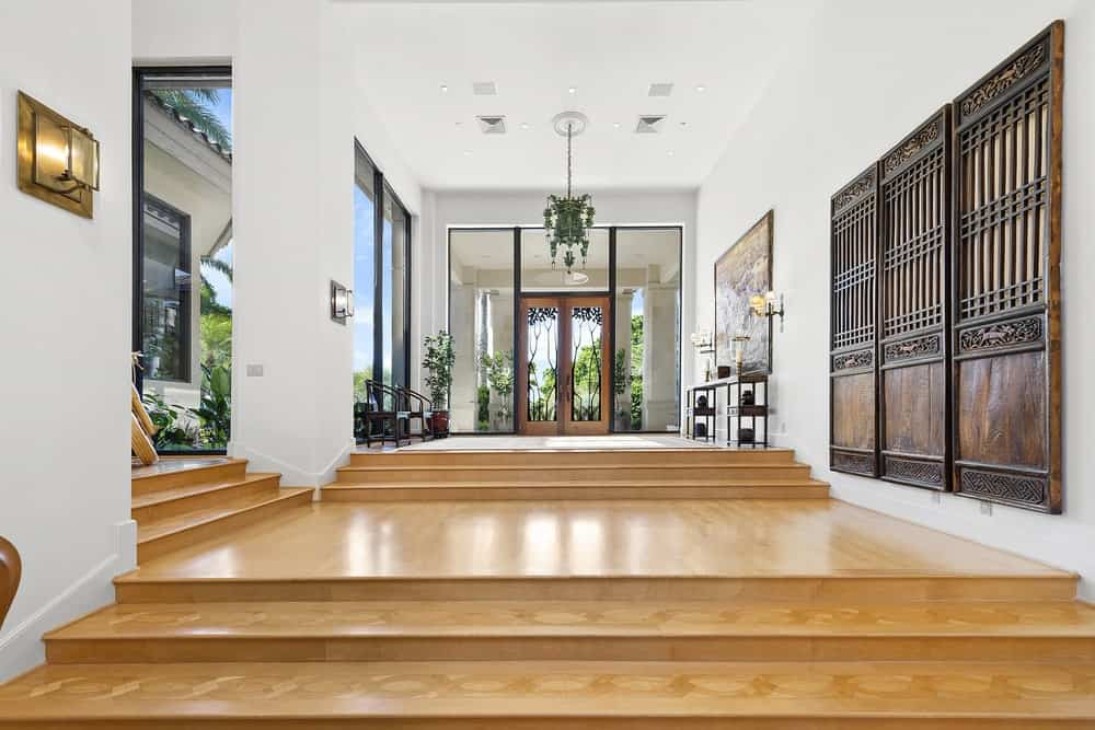 This beautiful and bright foyer has an abundance of natural lighting coming from the glass walls and doors balanced by the hardwood flooring. Images courtesy of Toptenrealestatedeals.com.