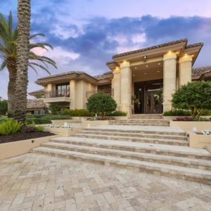 This is the main entryway of this luxurious mansion with large pillars and tall soaring ceiling over the entryway. Images courtesy of Toptenrealestatedeals.com.