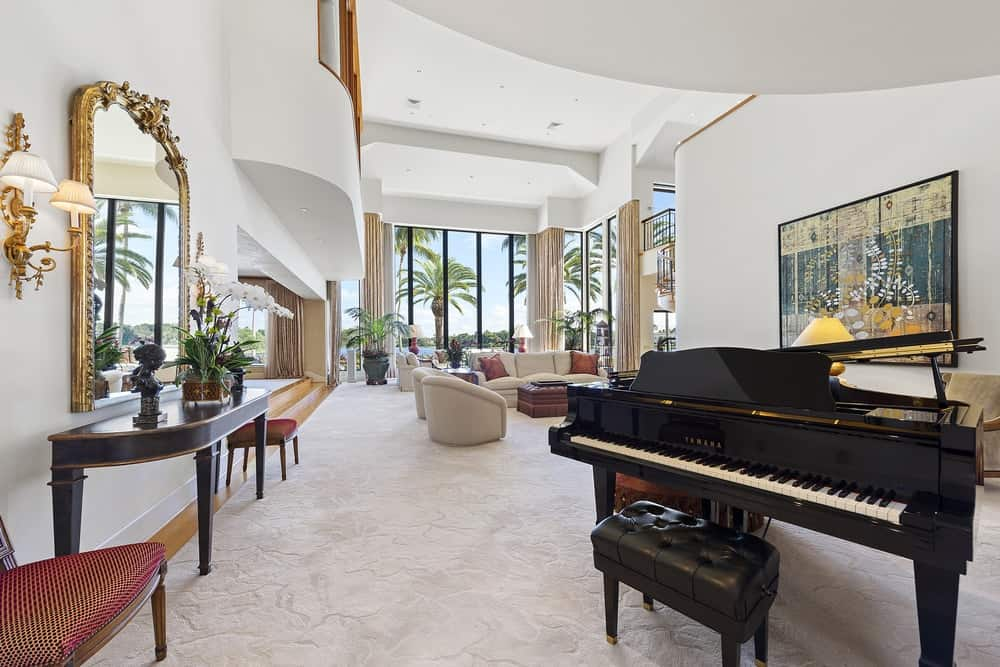A few steps away from the first piano is another piano that pairs well with the console table beside it that contrasts the bright white walls. Images courtesy of Toptenrealestatedeals.com.