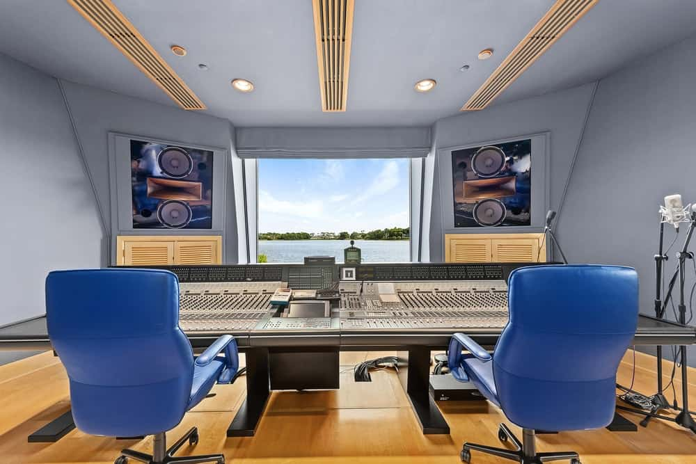 This is the state-of-the-art modern recording studio with warm gray walls brightened by the large glass window. Images courtesy of Toptenrealestatedeals.com.
