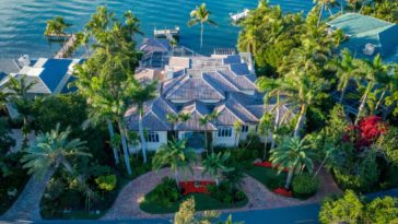 Aerial view of the house showcasing its exterior and landscaping plants and trees. Images courtesy of Toptenrealestatedeals.com.