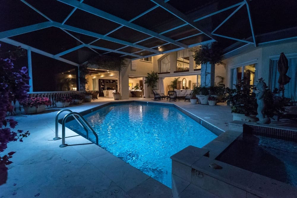 Here's the custom swimming pool with lots of plants and flowers on the side. Images courtesy of Toptenrealestatedeals.com.