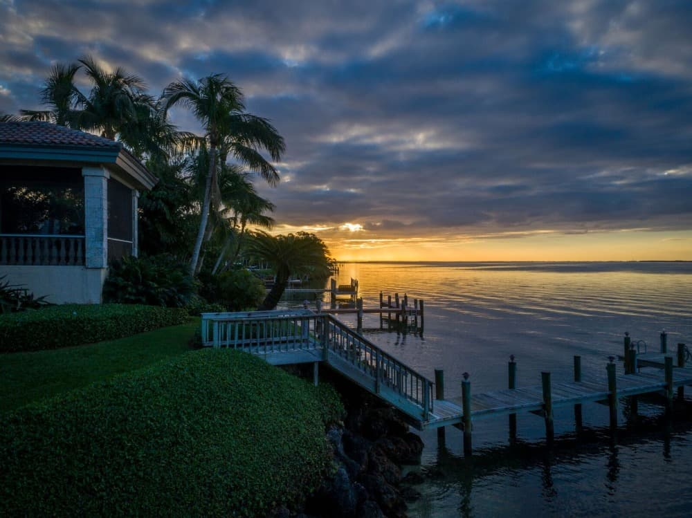 A stunning view of the sunset taken near the home's boat dock. Images courtesy of Toptenrealestatedeals.com.