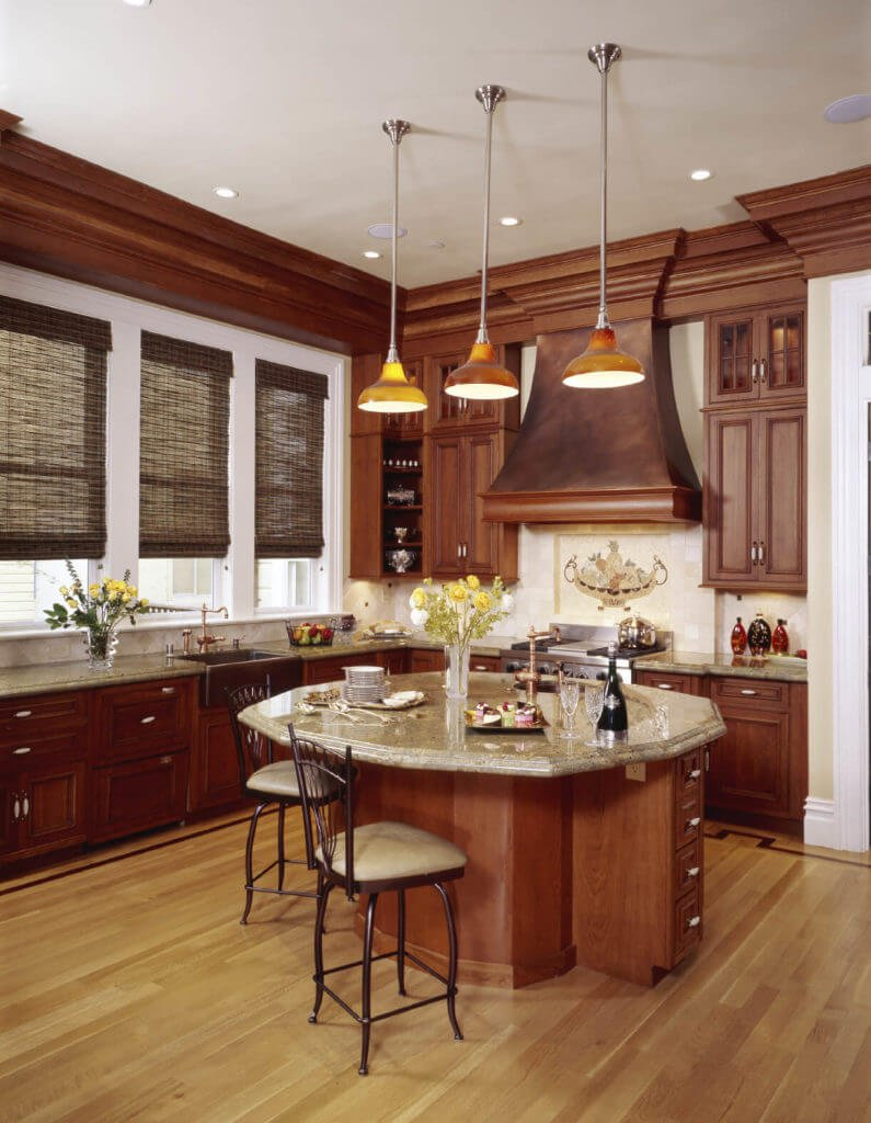 The light floor utilized in this kitchen draws out the light shades of the ledge and backsplash and takes into account the ruddy shade of the cabinetry to stick out.