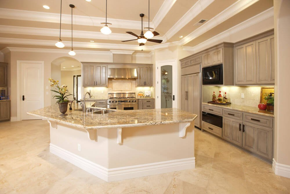 Minimalist kitchen showcases beige tile flooring and beamed ceiling with hanging glass globe pendants and fancy ceiling fan.