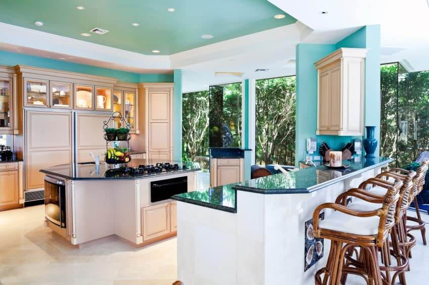 The brilliant green roof and dividers give a chipper disposition to this kitchen that has enormous glass windows highlighting rich greenery outside that improve the green components.