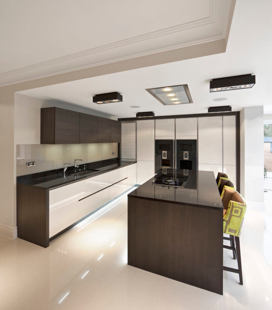 Modern kitchen including a stylish kitchen counter with a black countertop similar to the breakfast bar.
