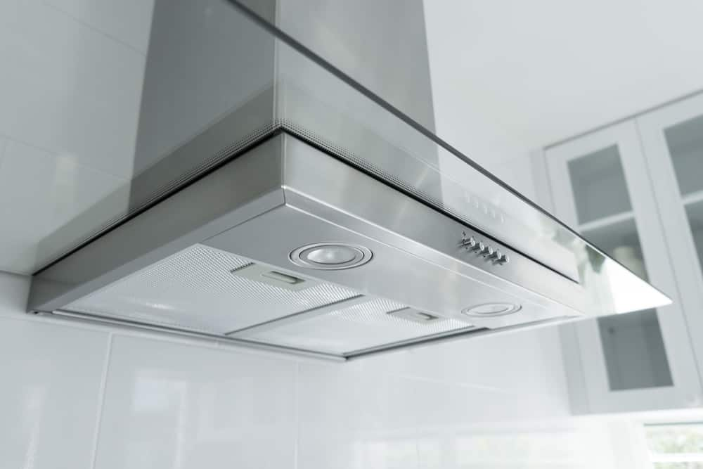 This is modern vent hood fitted with glass and stainless steel.