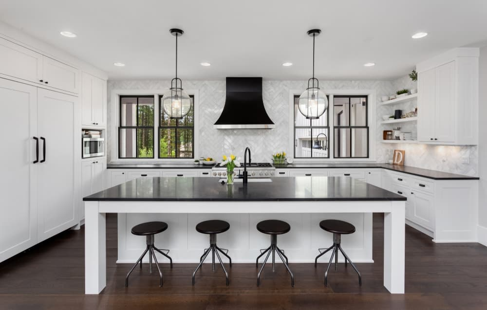 A beautiful kitchen that has a large kitchen island in the middle.