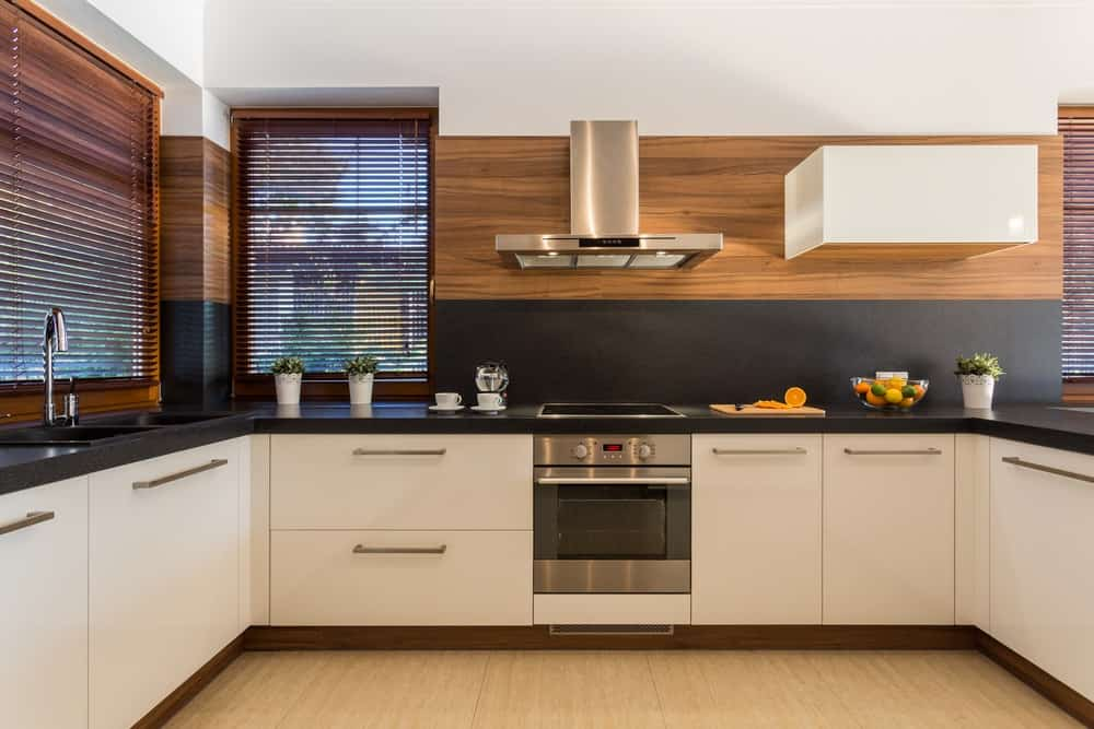 A charming U-shaped kitchen with a large space in the middle for movement.
