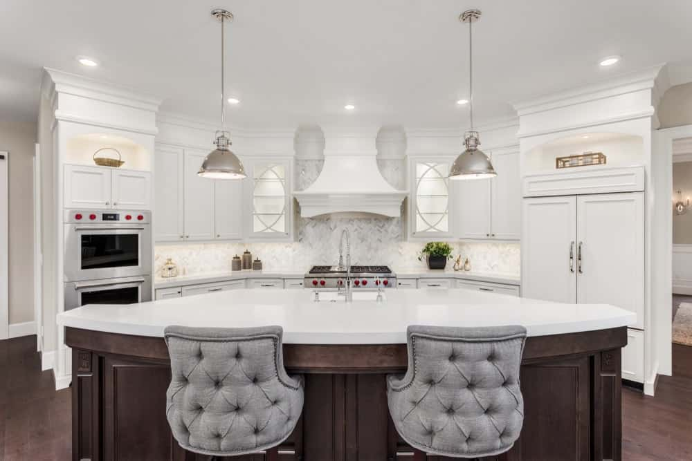 An angled kitchen that centers on the cooking area to easy access to the different areas of the kitchen.