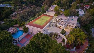 This aerial view of the property showcases its custom swimming pool and its tennis court. Images courtesy of Toptenrealestatedeals.com.